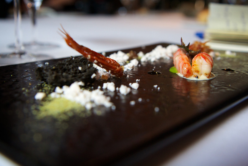 A whole king prawn:  Charcoal grilled king prawn, king prawn sand, ink rocks, fried legs, head juice and king prawn essence.