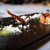 A whole king prawn:  Charcoal grilled king prawn, king prawn sand, ink rocks, fried legs, head juice and king prawn essence.