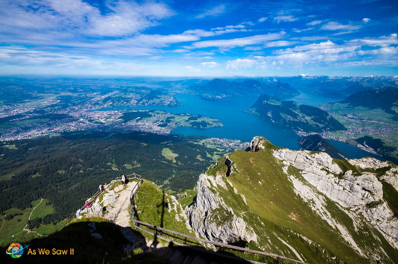view from Mount Pilatus goes all the way to the horizon. On the ground, low mountains just up around a large lake