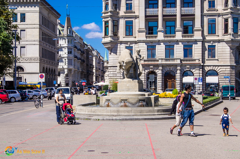 fountain and families on a shopping street in Zurich Switzerland