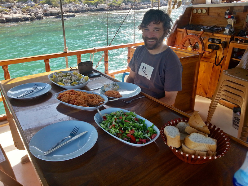 Warren sitting down on the boat for a lunch feast!