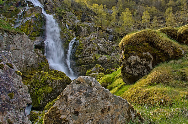 Scenic water falls and ancient mossy rocks on the hike to the The Briksdalsbreen glacier, south of Olden, at the end of the Oldedalen valley. (Jim)