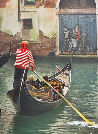 Gondola and street artwork in Venice, Italy, 0573