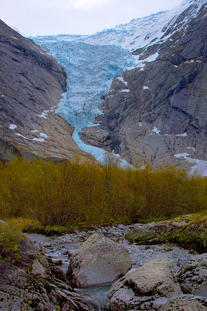 The Briksdalsbreen glacier, a popular hiking destination in Norway, is located about 25 kilometres (16 mi) south of Olden, at the end of the Oldedalen valley (Jim).