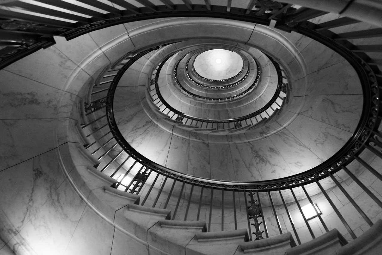 Looking up the marble stairwell inside the Supreme Court. Washington DC,  digital, Mar 2015.