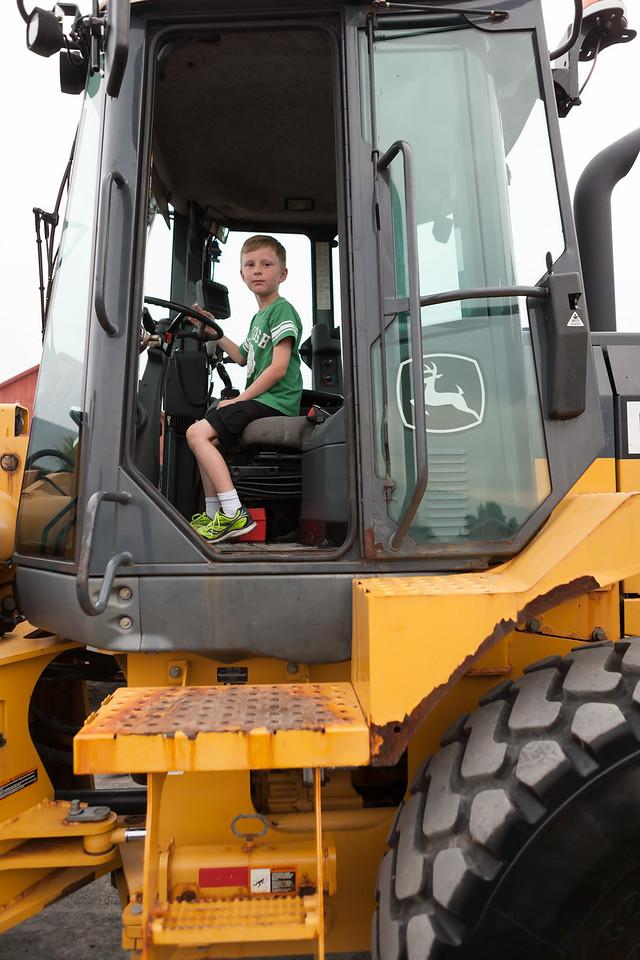 Kyle on the front-end loader. Digital. Summer 2014.