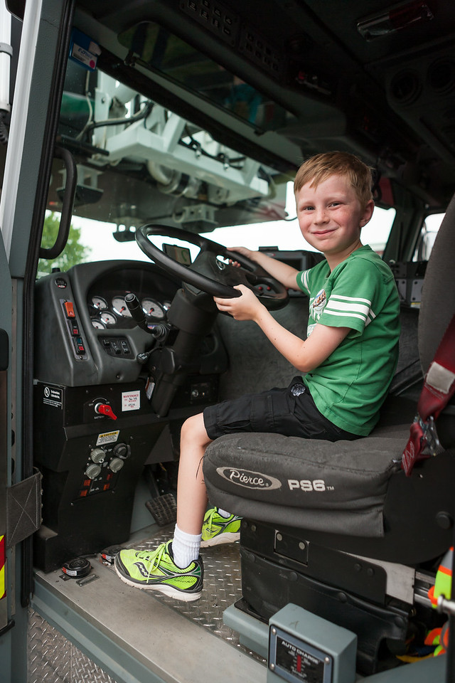 Kyle in the fire engine...aka his happy place. Digital. Summer 2014.