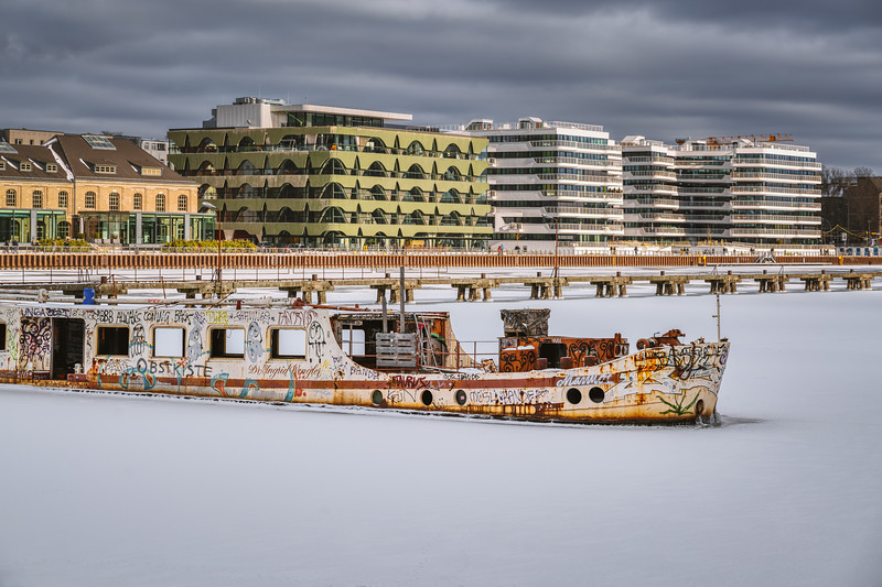 Abandoned boat in frozen Spree river