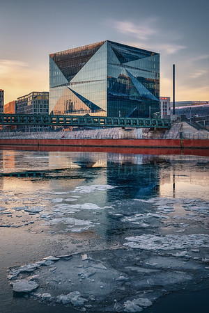 Water with ice floes reflect architecture at the main station
