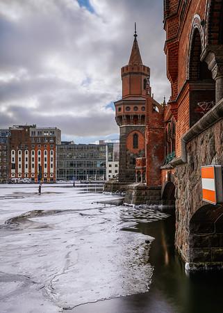 Oberbaum bridge in winter with frozen Spree river