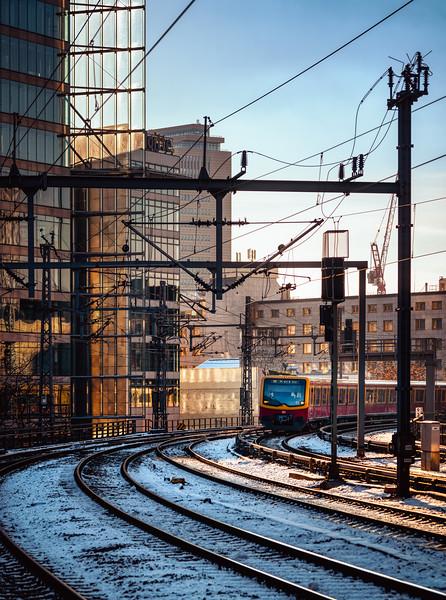 Railroad tracks in urban environment with S-Bahn train