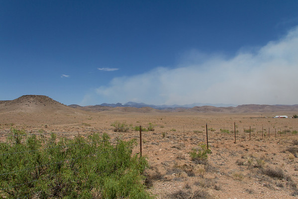 Between Lake Valley and Hillsboro, NM.  Clouds on horizon are from the wildfire in the Gila National Forest.
