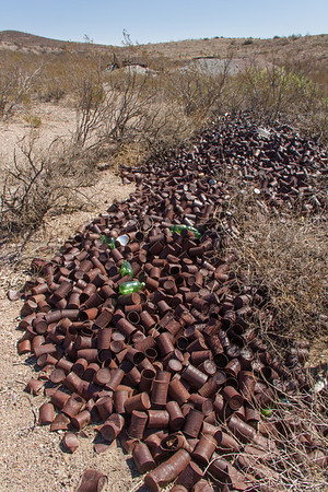 A river of old tin cans -- and a few contemporary bottles -- which do not biodegrade well in the desert climate.