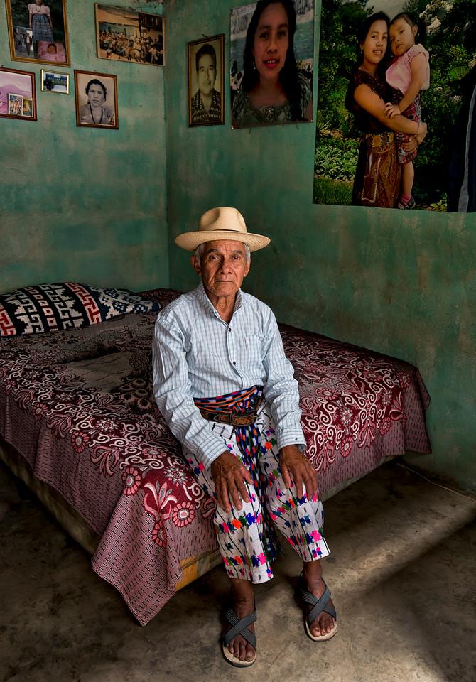 A Mayan man sitting in his bedroom.<br /> <br /> San Pedro La Laguna, Guatemala, 2014.