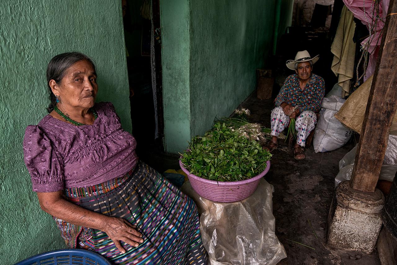 Mayan Couple outside there home preparing vegetables to take to market.<br /> <br /> Santiago de Atitlan, Guatemala, 2014.