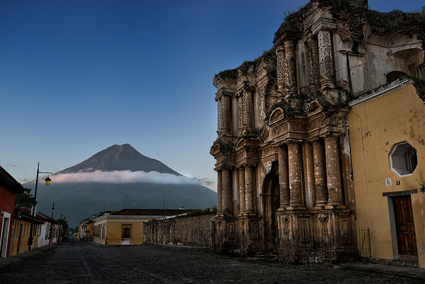 """The """"Iglesia el Carmen"""" is a church in Antigua Guatemala that stands as ruins. El Carmen is very unique because of its color and architecture, and certainly makes your imagination wonder how would it of looked during its golden years.  Its history dates back to 1638 when permission was obtained for its construction, motion requested by the title of Our Lady of Carmen. It suffered damages during the earthquakes of 1717, 1728 and 1773, finally being ruined and closed to the public, but its facade speaks of its current and past beauty.  It is accentuated by a baroque style, and stucco columns decorated with floral designs. Unlike other churches of La Antigua Guatemala, its facade has no images and displays twenty-four sets of columns, all decorated with stucco details.   Antigua, Guatemala, 2014."""
