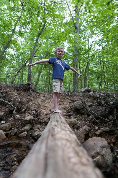 Kyle navigating the log bridge over the creek behind our campsite. Digital, Trout Pond Recreation Area, West Virginia, Jun 2014.