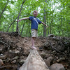 Kyle navigating the log bridge over the creek behind our campsite. Digital, Trout Pond Recreation Area, West Virginia, Jun 2014.