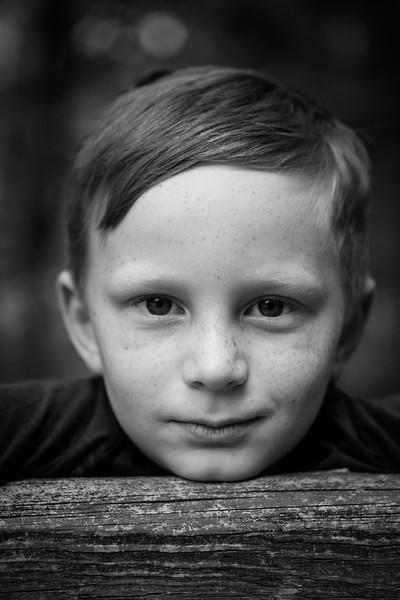 B&W of Kyle sitting on the fencepost. Digital, Trout Pond Recreation Area, West Virginia, Jun 2014.