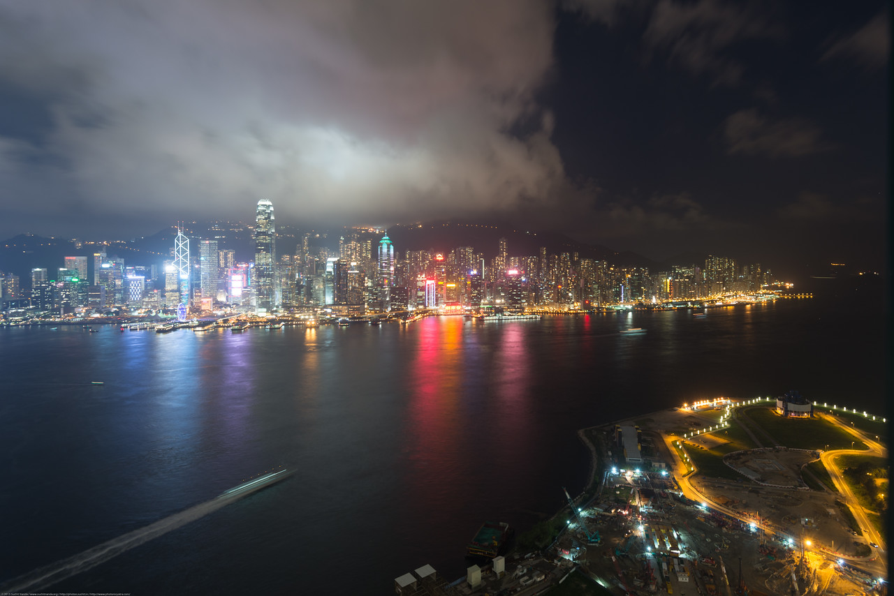Panoramic Hong Kong night Skyline as seen from Kowloon.