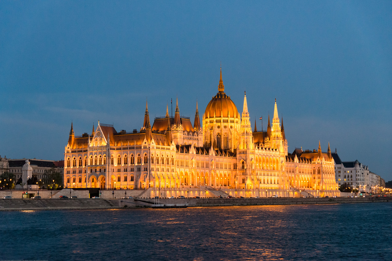 NIght view of Hungarian Parliament Building, Budapest, Hungary from the river cruise. This landmark Gothic revival–style edifice has lavishly decorated rooms, plus a visitors' center.
