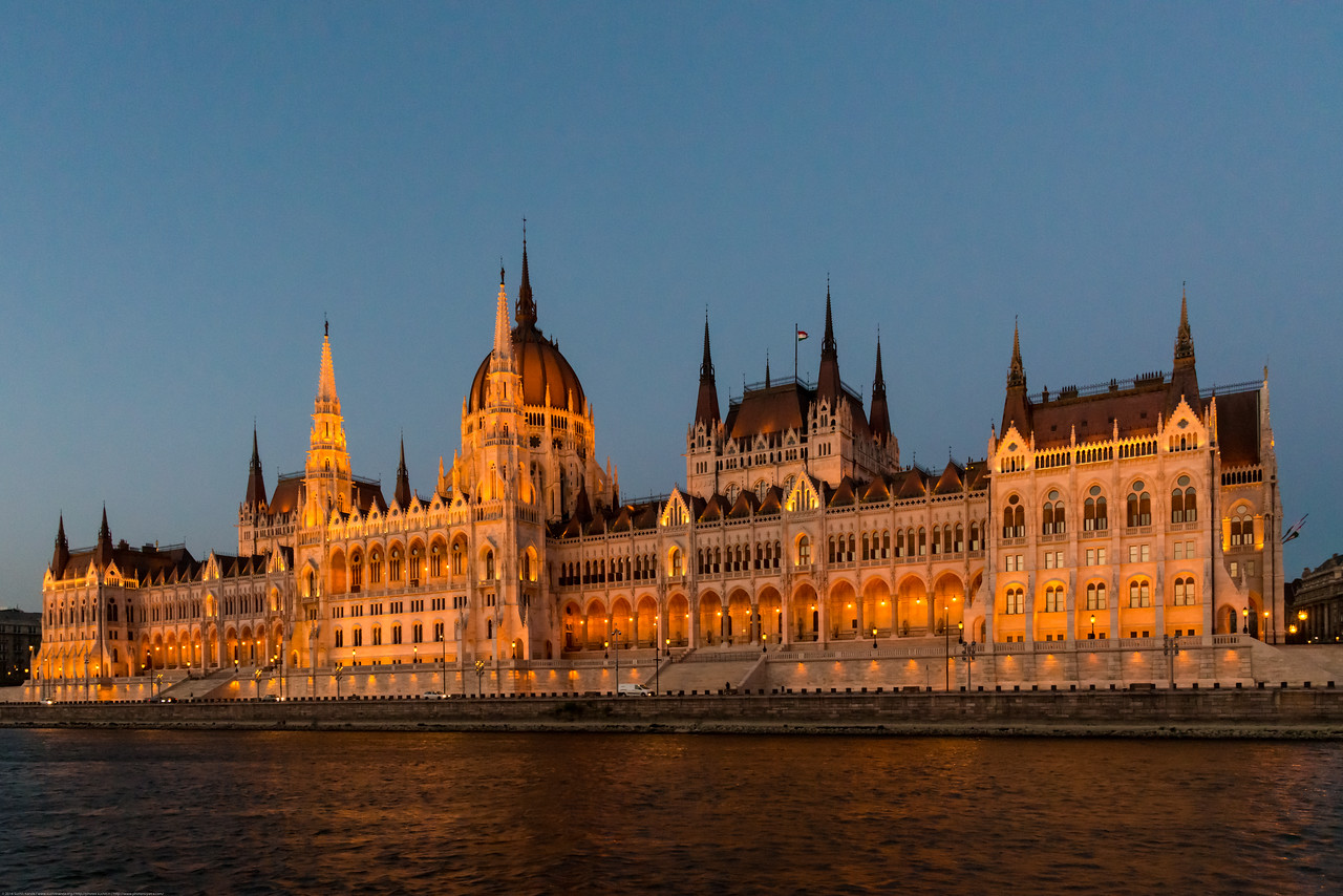 Late evening light on the Hungarian Parliament Building (Hungarian: Országház  - House of the Country or House of the Nation), also known as the Parliament of Budapest is the seat of the National Assembly of Hungary, one of Europe's oldest legislative buildings, a notable landmark of Hungary and a popular tourist destination of Budapest. It lies in Lajos Kossuth Square, on the bank of the Danube. It is currently the largest building in Hungary and still the tallest building in Budapest.