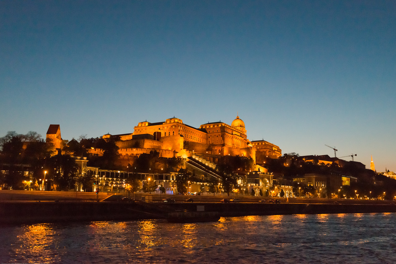 Buda Castle at night viewed from Danube River cruise. NIght view of Budapest, Hungary from the river cruise.