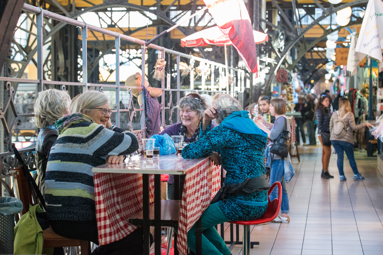 Many enjoy the food at Mercado Central (Central Market Hall), Budapest, Vámház körút, Hungary. The neogothic market hall has been restored for traders with grocery produce on the ground & souvenirs on the 1st floor.