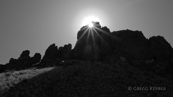 Sun shining through hole in the rocks