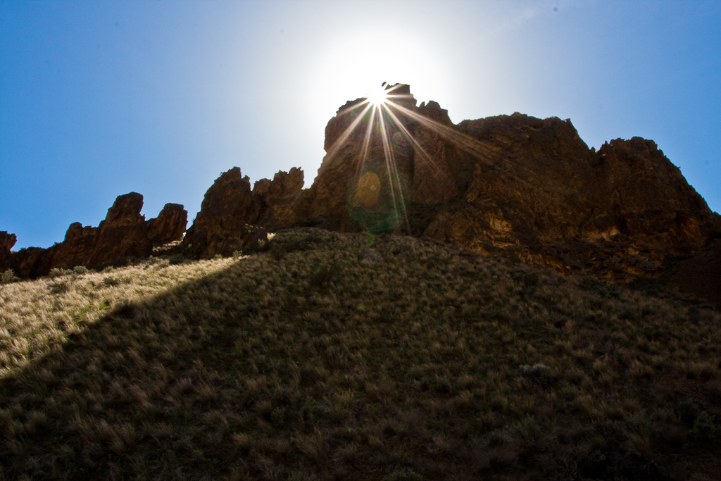 Sun coming through hole in rock in Leslie Gulch