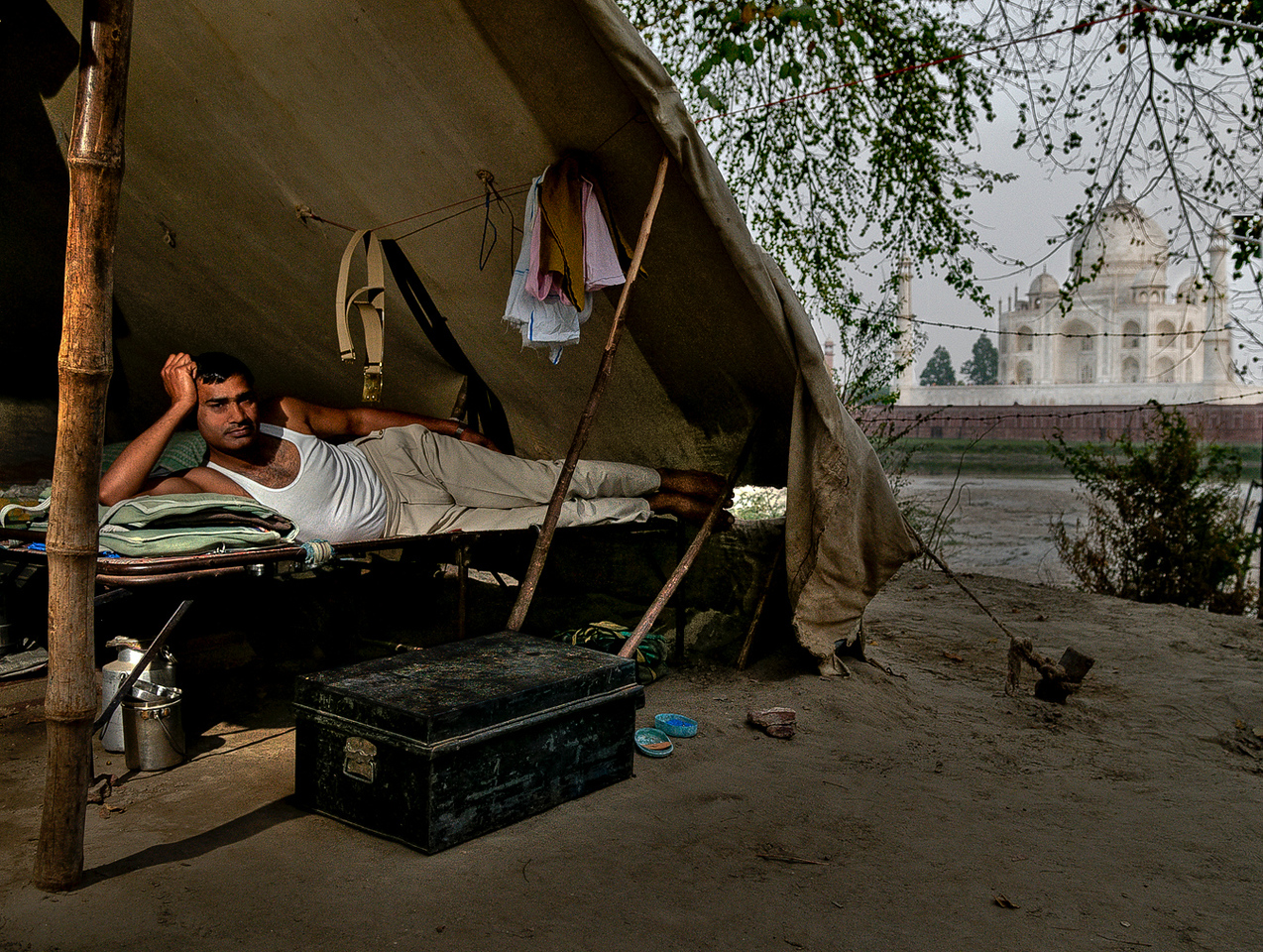 Soldier rests in his tent at the security post at the Taj Mahal. <br /> <br /> Agra, India, 2011.