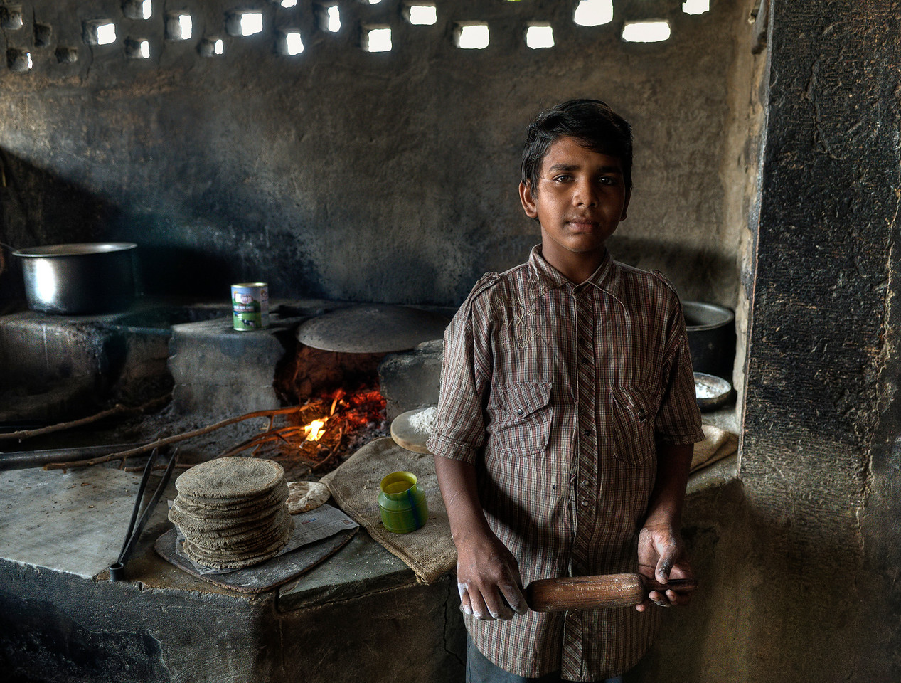 Young Waiter in a truck stop restaurant on the road a few kilometers outside Jaisalmer.<br /> <br /> Rajasthan, India, 2011.