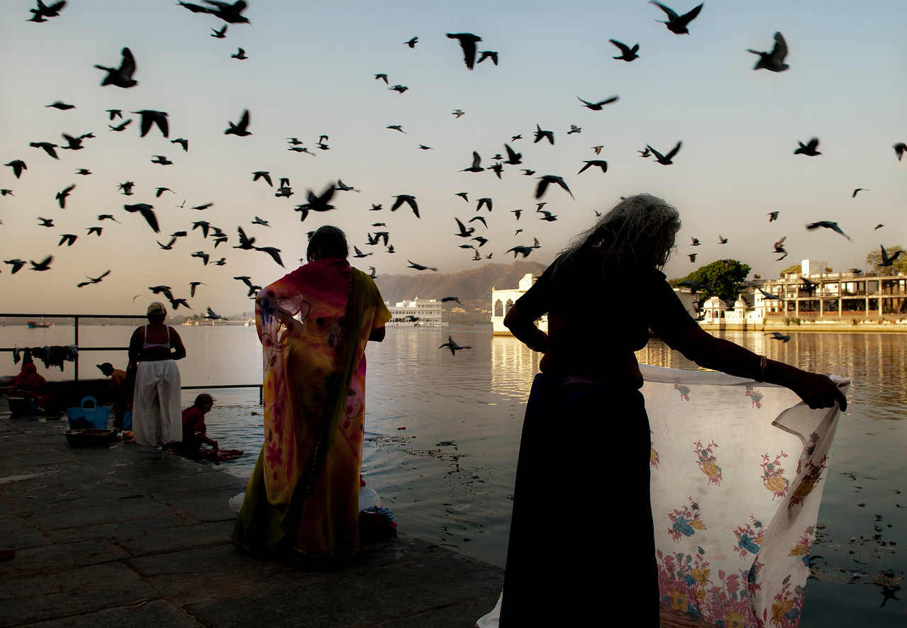 Women washing themselves and there clothes at the lake in Udaipur.<br /> <br /> Rajasthan, India, 2011.