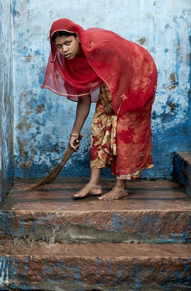 Hindu woman washing steps in Bundi.<br /> <br /> Rajasthan, India, 2011.