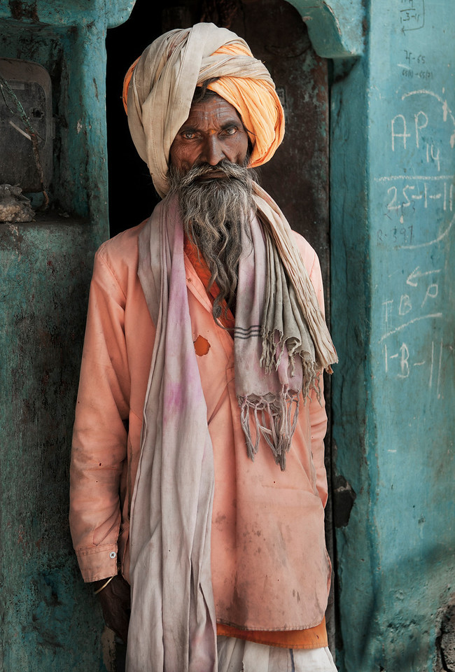 Portrait of a holy Sadhu. <br /> To Hindus, spiritual enlightenment has always represented the highest goal in life, the one thing that gives it meaning and purpose.<br /> Moreover, enlightenment is a state of being that is in principle attainable by everybody. <br /> The average individual, however, would need many incarnations to become enlightened, to see God, to become one with the Absolute, to merge one's mind with Cosmic Consciousness -- in short, to become holy.<br /> <br /> But since time immemorial shortcuts have been available for people wanting to become enlightened in this life rather than the next.<br /> Those who follow the fast track, mostly men, are the sadhus, the 'holy men' of India.<br /> For thousands of years they have been around. Once they must have been more numerous, but even today there are still four to five million sadhus, constituting about half a percent of the total population.<br /> Organised in various sects, they passed on the wisdom of old, the method of yoga, that is 'yoking' soul and Soul together.<br /> Usually they live by themselves, on the fringes of society, and spend their days in devotion to their chosen deity.<br /> <br /> Udaipur, Rajasthan, India, 2011.