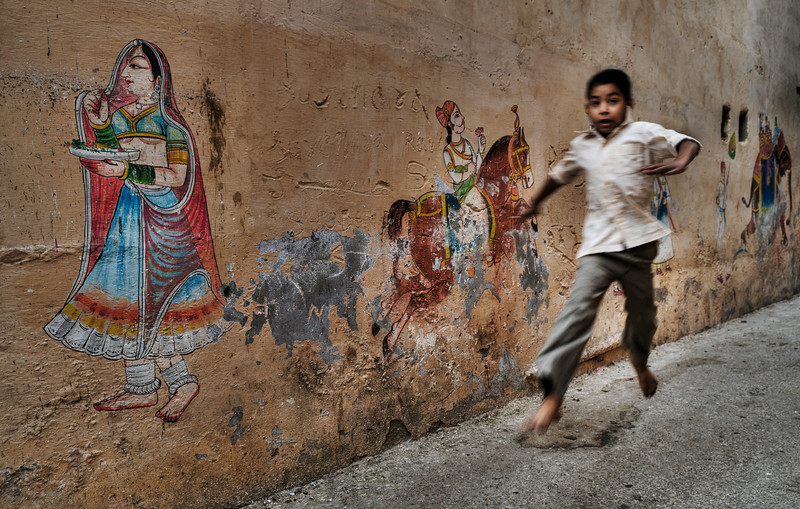 Boy running in the streets.<br /> <br /> Bundi, Rajasthan, India, 2011.