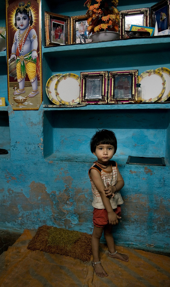 Small boy in his home in the town of Bundi.<br /> <br /> Rajasthan, India, 2011.