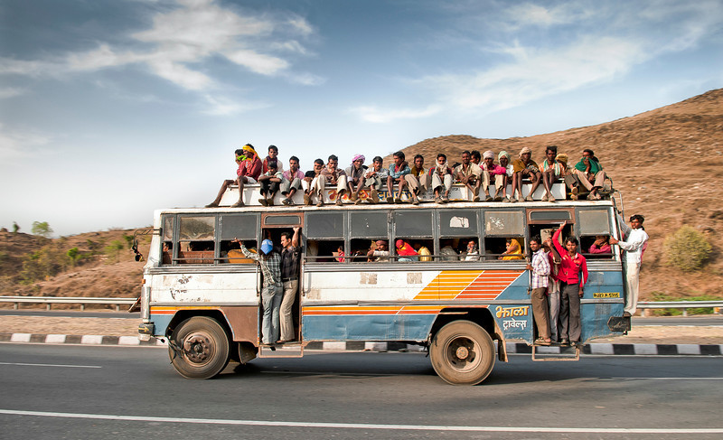 Public buses in India as seen in this image can sometimes be a little overcrowded. This coupled with poor maintenance and lawless roads, full of unpredictable drivers can make any bus ride an adventure not for the faint hearted. <br /> <br /> Rajasthan, India, 2011.