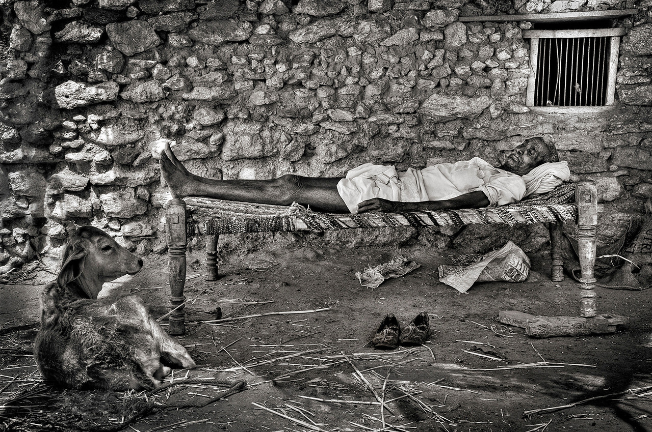 Man sleeping outside his hut in a small village outside Bundi.<br /> <br /> Rajasthan, India, 2011.