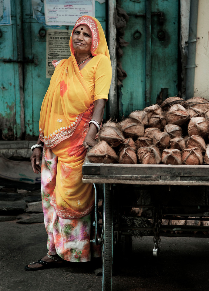 Woman selling coconuts.<br /> <br /> India,2011.