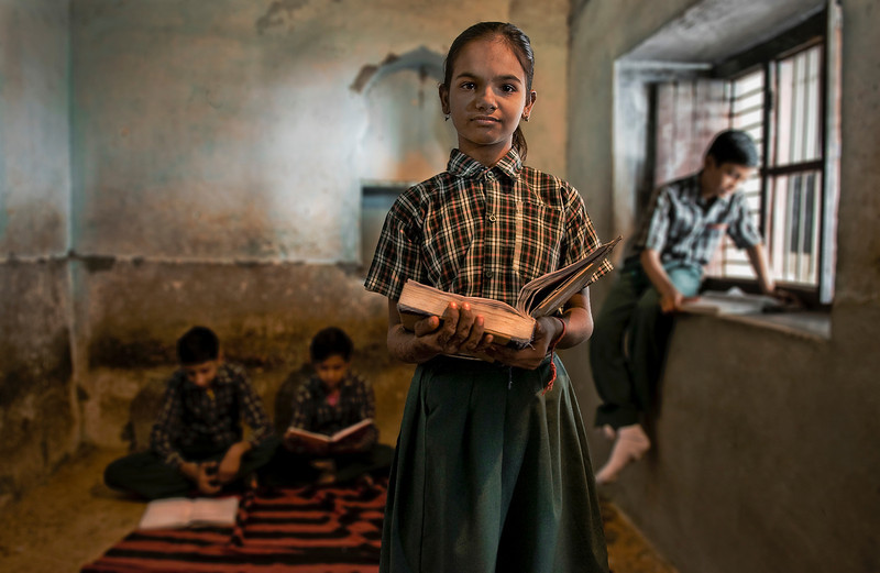 Women have a much lower literacy rate than men. Far fewer girls are enrolled in the schools, and many of them drop out. The chief barrier to female education in India are inadequate school facilities (such as sanitary facilities), shortage of female teachers and gender bias in curriculum (majority of the female characters being depicted as weak and helpless). Conservative cultural attitudes, especially among Muslims, prevents some girls from attending school.  School in Bundi, Rajasthan, India, 2011.