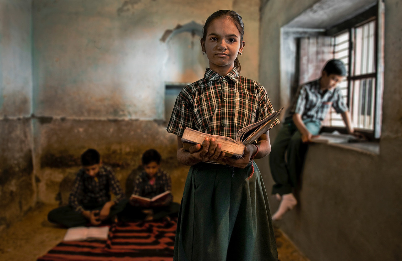 Women have a much lower literacy rate than men. Far fewer girls are enrolled in the schools, and many of them drop out. The chief barrier to female education in India are inadequate school facilities (such as sanitary facilities), shortage of female teachers and gender bias in curriculum (majority of the female characters being depicted as weak and helpless). Conservative cultural attitudes, especially among Muslims, prevents some girls from attending school.<br /> <br /> School in Bundi, Rajasthan, India, 2011.