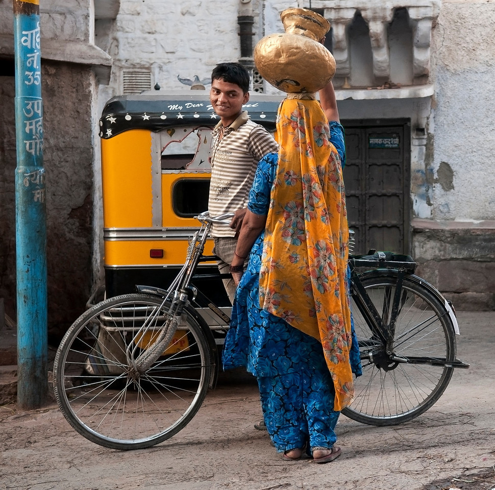 Young man flirting with a young lady in the small town of Bundi.<br /> <br /> Rajasthan, India, 2011.