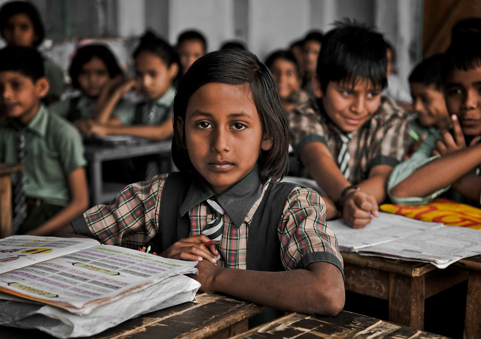 The education of women in India plays a significant role in improving livings standards in the country. A higher women literacy rate improves the quality of life both at home and outside of home, by encouraging and promoting education of children, especially female children, and in reducing the infant mortality rate. Several studies have shown that a lower level of women literacy rates results in higher levels of fertility and infant mortality, poorer nutrition, lower earning potential and the lack of an ability to make decisions within a household. Women's lower educational levels is also shown to adversely affect the health and living conditions of children. A survey that was conducted in India showed results which support the fact that infant mortality rate was inversely related to female literacy rate and educational level. The survey also suggests a correlation between education and economic growth.<br /> <br /> School in Bundi, Rajasthan, India, 2011.