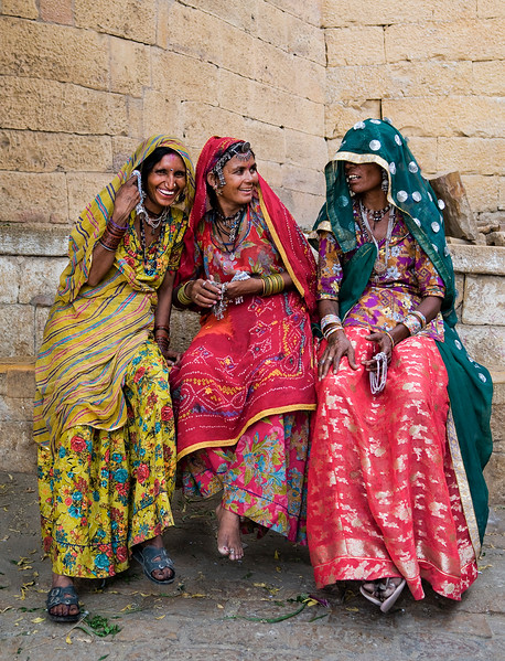 Jewellery sales women outside the fort in the desert town of Jaisalmer.<br /> <br /> Rajasthan, India, 2011.
