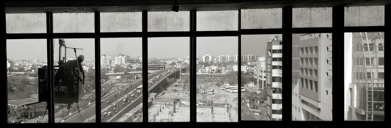 View of modern Jaipur through a hotel window.<br /> <br /> Jaipur, Rajasthan, India, 2011.