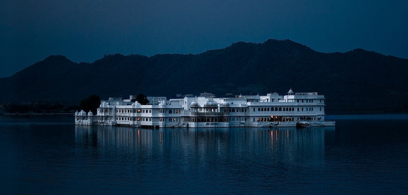 "The Lake Palace was built in 1743-1746. It is made of marble and is situated on Jag Niwas island in Lake Pichola. It was originally built as a royal summer palace, but is now a luxury 5 Star hotel, operating under the ""Taj Hotels Resorts and Palaces"" banner.<br /> <br /> Udaipur, Rajasthan, India, 2011."