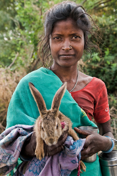 Village girl and her rabbit.<br /> <br /> Small village outside Udaipur, Rajasthan, India, 2011.