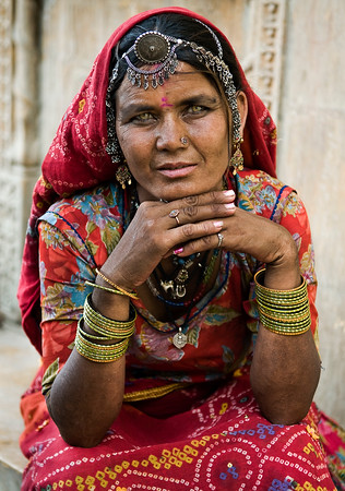 The women take pride in their traditional jewellery and Rajasthani womenfolk cherish their heritage. The pieces of jewellery are often heirlooms and passed down in families. The Rakhri, Bindi and Borla are the main head ornaments of the women of the state. Besides these, they use an assortment of jeweled pins, clips and hair brooches. The Nath is a nose ring that holds a very important place in the woman's adornments. It is considered auspicious and worn on every joyous occasion.  Jaiselmeer, Rajasthan, India, 2011.