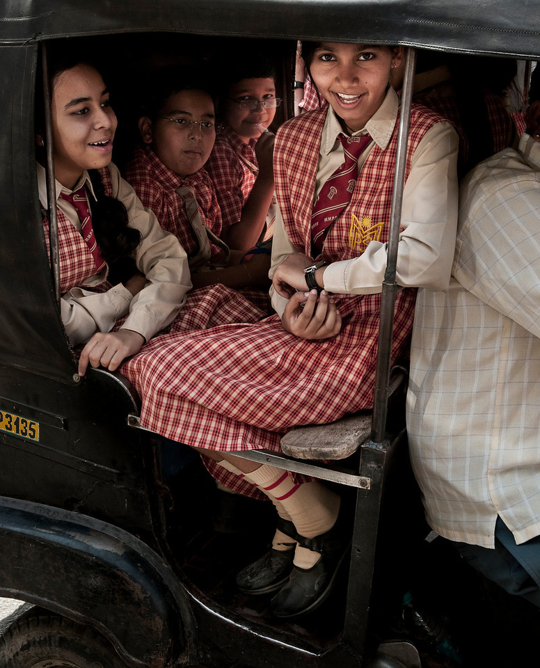 Kids from more affluent families on there way to school in a rickshaw.<br /> <br /> Udaipur, Rajasthan, India, 2011.